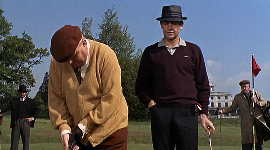 007 watches Goldfinger putt during the 1964 Bond film: Ian Fleming, the book's author based the ficticious Royal St. Mark's course on his home club at Sandwich