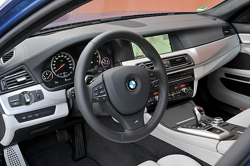 The interior is lush, trimmed in supercar materials