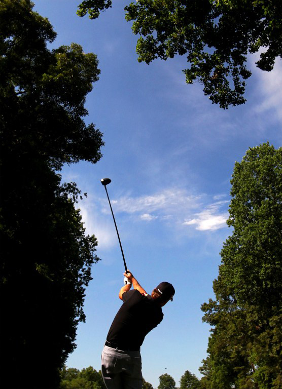 Graeme McDowell hits a tee shot during a practice round