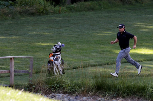 Graeme McDowell of Northern Ireland runs to a tee box during a practice round at the 111th US Open