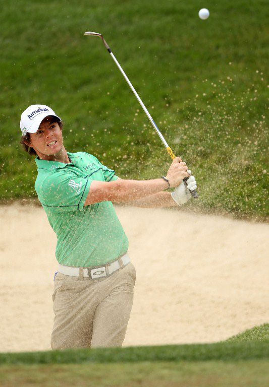 Rory McIlroy hits a bunker shot during a practice round priorto the 111th US Open