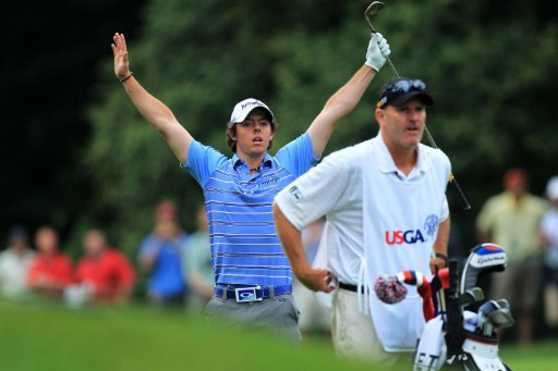 McIlroy raises his hands in celebration of his 8th hole eagle