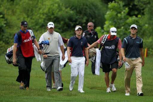 Westwood, Donald, and Kaymer walk together during the 1st round of the 111th US Open