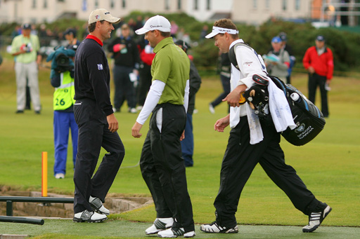 Padraig Harrington walks past Sergio Garcia