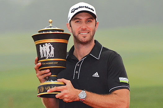 Dustin Johnson held off the challenge of Ian Poulter to win his first title on Asian soil