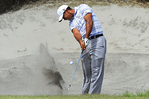 Tiger Woods plays from one of Royal Melbourne's splendidly designed bunkers