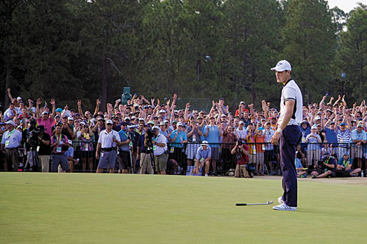 Kaymer reacts to holing a lengthy par putt on the 72nd hole at Pinehurst