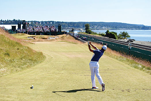 Rory McIlroy plays his tee shot at the par-4 17th at Chambers Bay