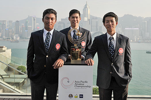 Hong Kong's Leon D'Souza, Matthew Cheung and Michael Regan Wong pose with the championship trophy