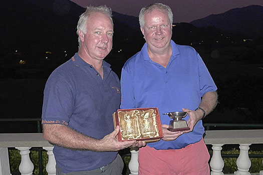 Alan McTaggart presents the trophy to winner Roy Kinnear