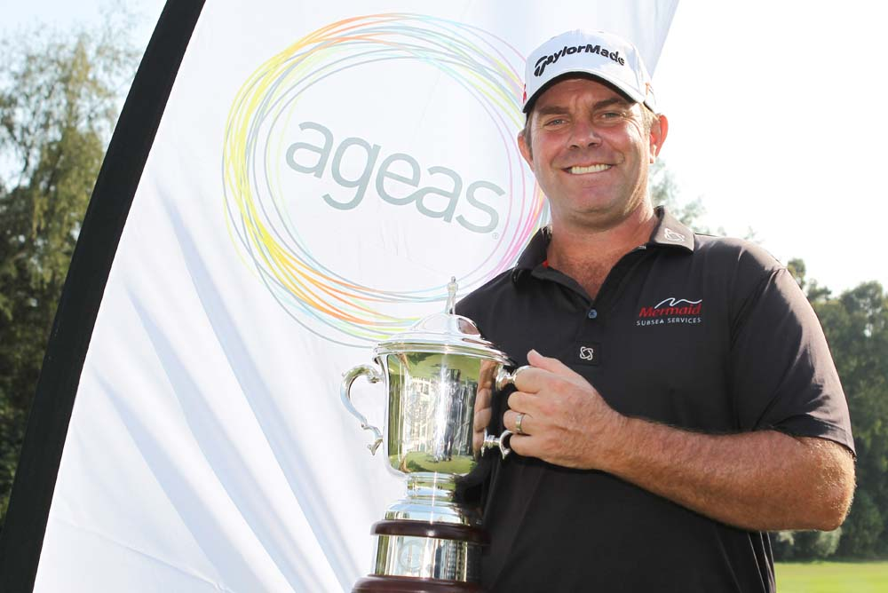 Scott Barr with his reward for the week: the Joe Hardwick Trophy