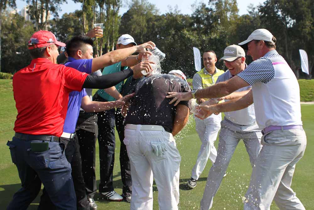 Barr being showered by his fellow competitors after holing the winning putt