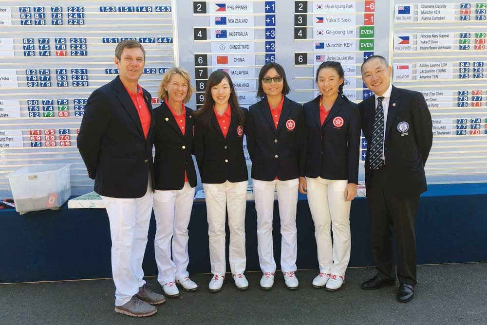 National Coach Brad Schadewitz, Ladies' Captain Joanne McKee and HKGA President Mark Chan flank the Hong Kong trio of Emily Leung, Virginie Ding and Chloe Chan