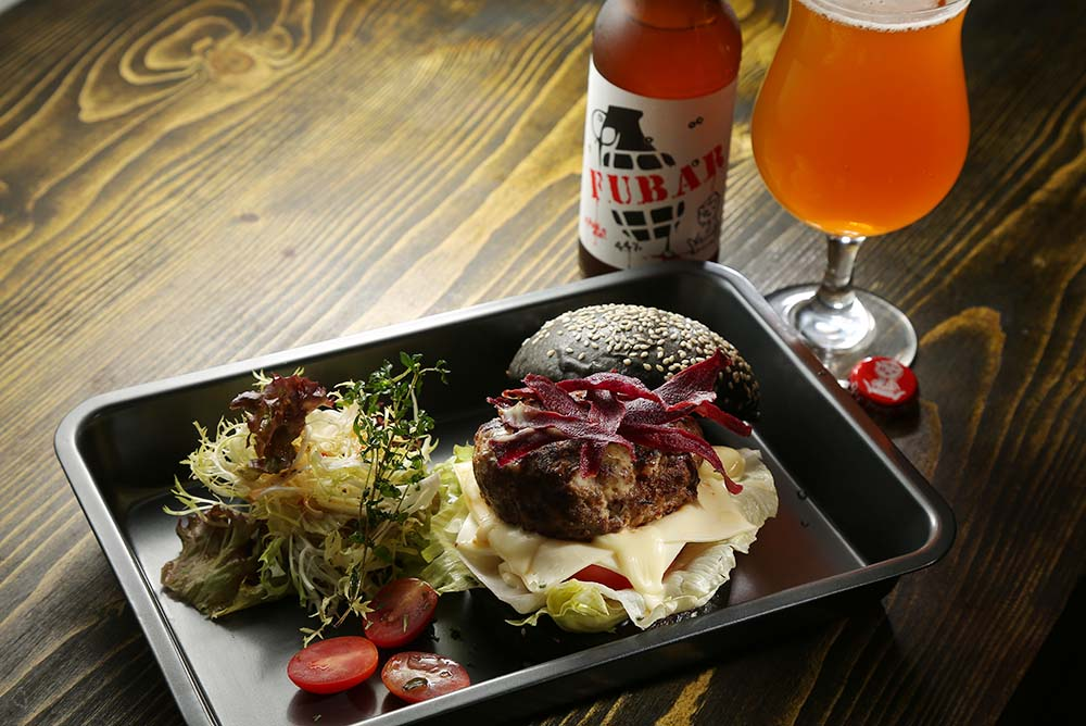 Snkrholic, located near the Sneaker Street in Mongkok, has a very tidy selection of craft beers. Their Great British Burger goes pretty well with an interesting mix of UK labels
