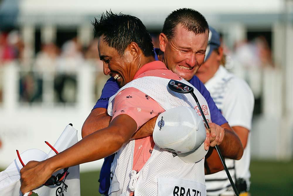 An emotional Brazel celebrates with his caddie
