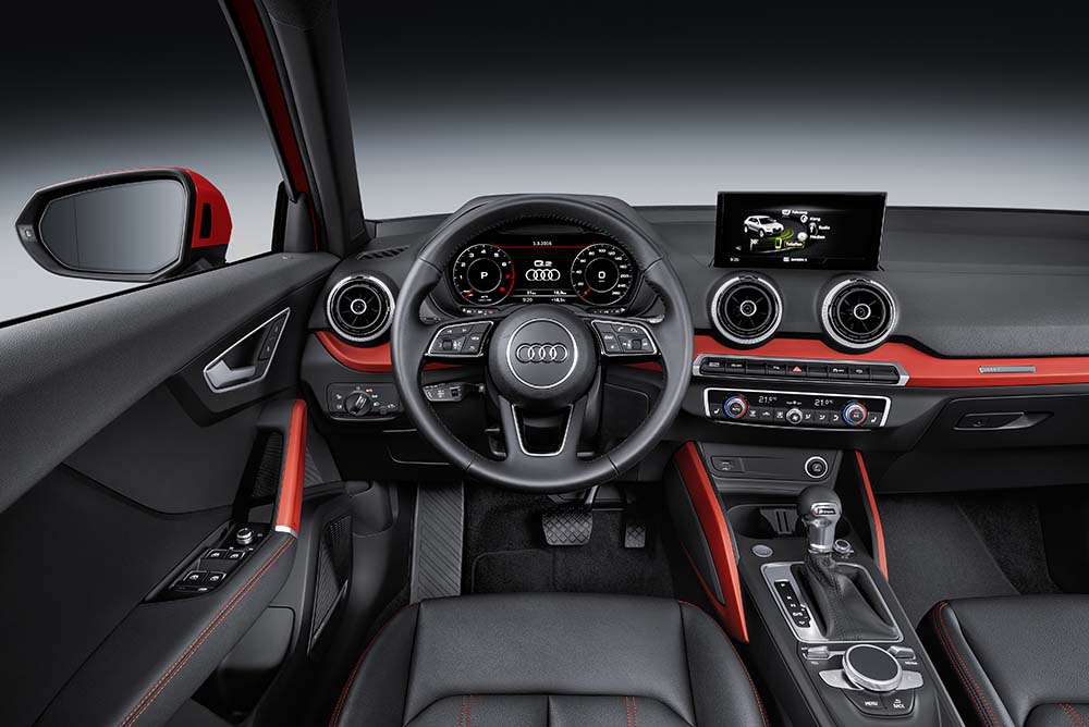 The driver's seat position is sporty and low in relation to the steering wheel