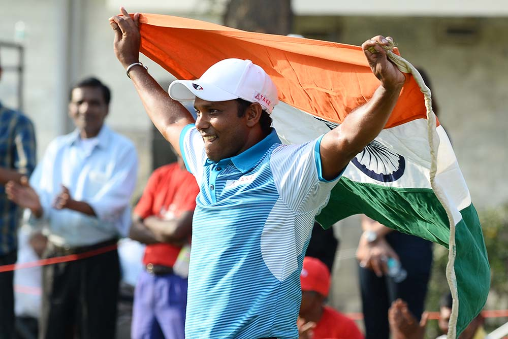 S.S.P Chawrasia holds up the national flag after winning his first European Tour Indian Open title on home soil in 2016