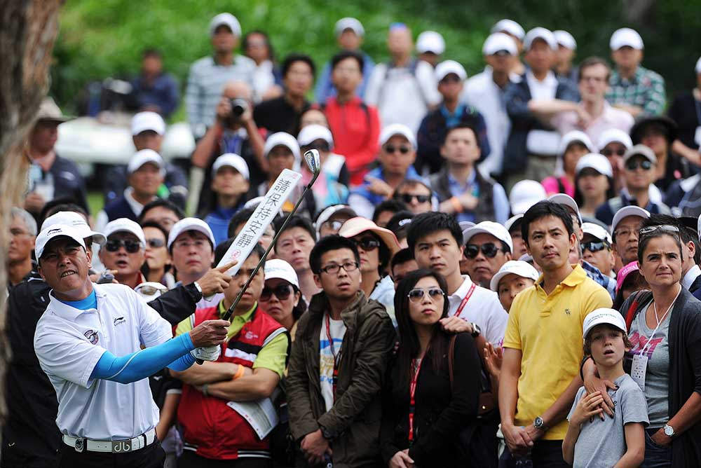 Zhang Lian-wei, who taught himself to play golf in 1990s, is the icon of the first generation of mainland Chinese golfers. The picture shows his tee-off from behind a tree during the 2012 UBS Hong Kong Open