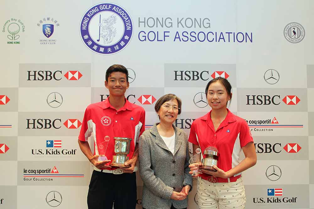 Taichi Kho and Virginie Ding receive their Hong Kong Junior Close Championship trophies from Sue Sue Tong, Clubhouse Manager of the Hong Kong Golf Club