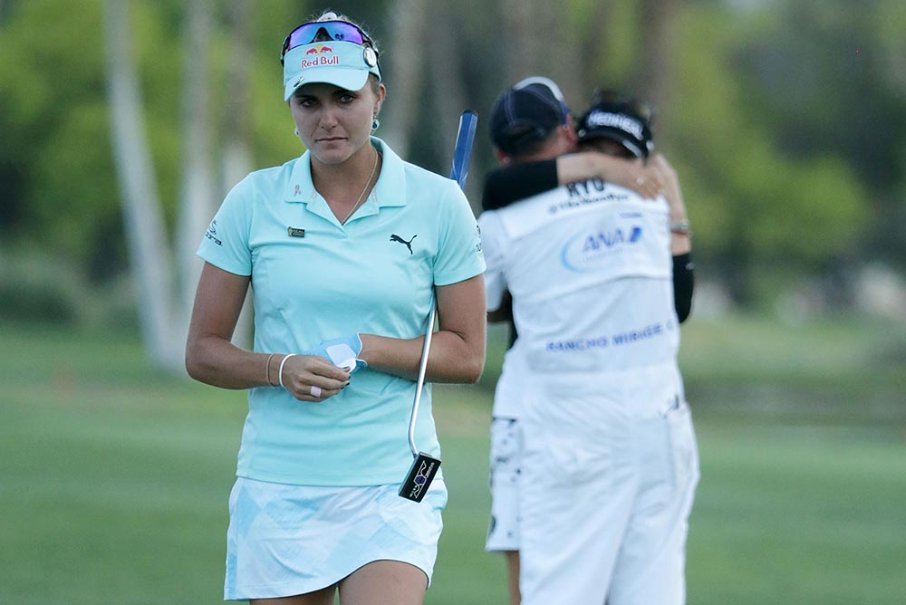 Lexi Thompson walks off the 18th green, as Korean So Yeon Ryu celebrates