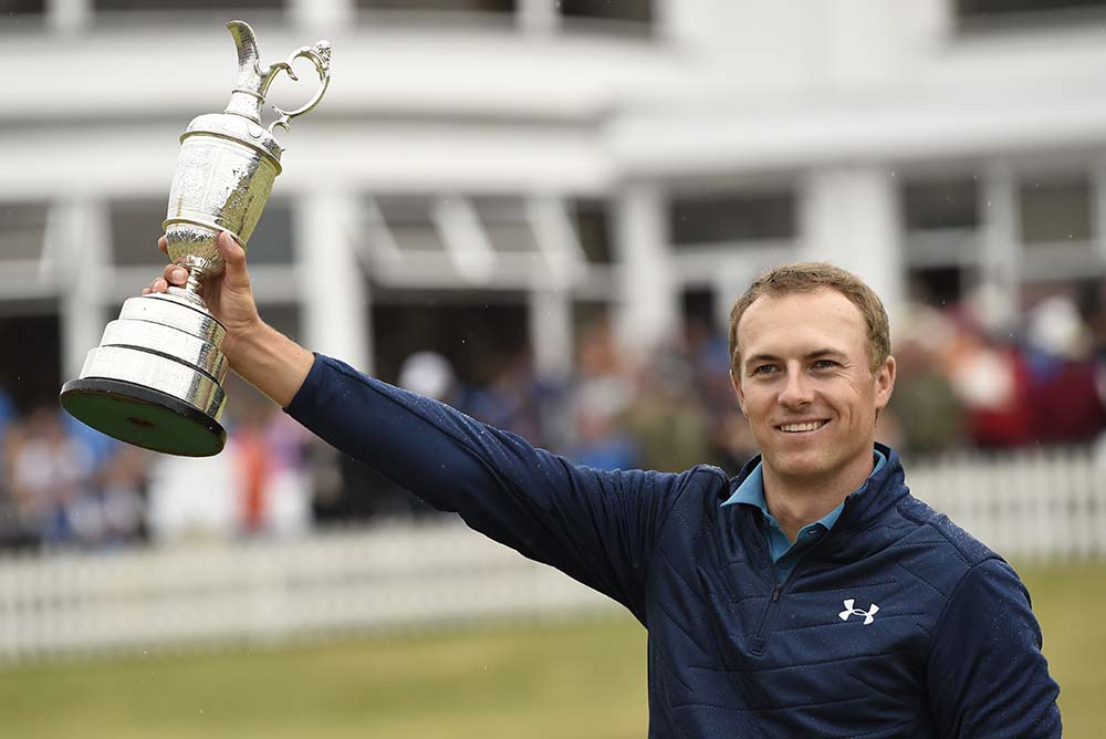 Jordan Spieth poses for pictures with the Claret Jug