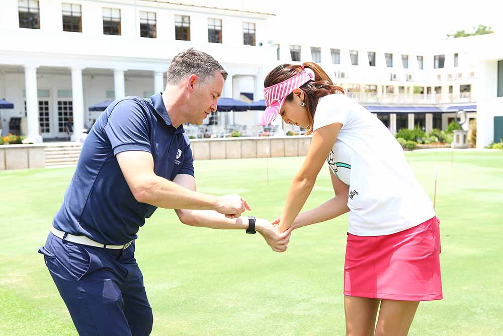 Hong Kong Golf Club's Director of Golf Dean Nelson works with Cindy on her grip