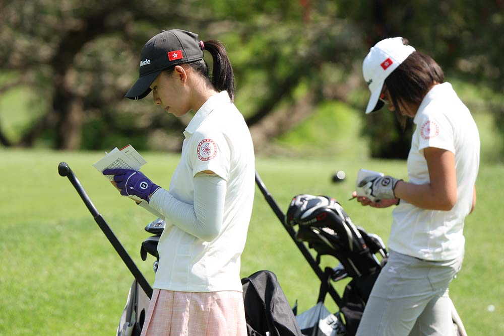 Virginie Ding and Chloe Chan mark their scores