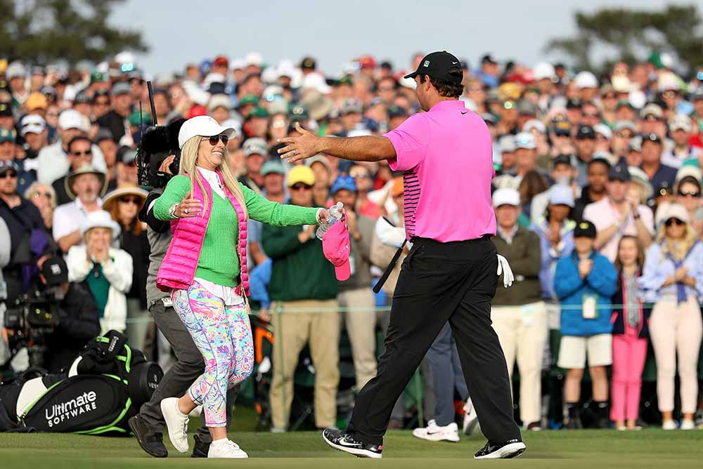 Patrick Reed celebrates with his wife Justine during the 2018 Masters Tournament
