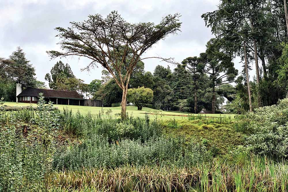 The 9th hole and clubhouse of Mount Kenya Safari Club