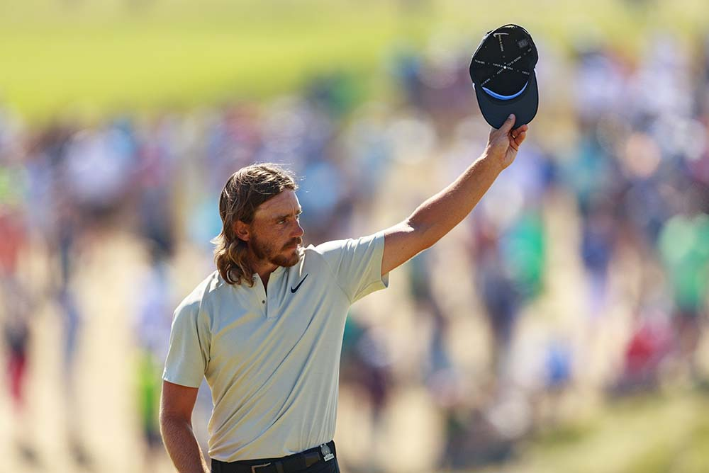 Fleetwood waves to the crowd on the 18th green