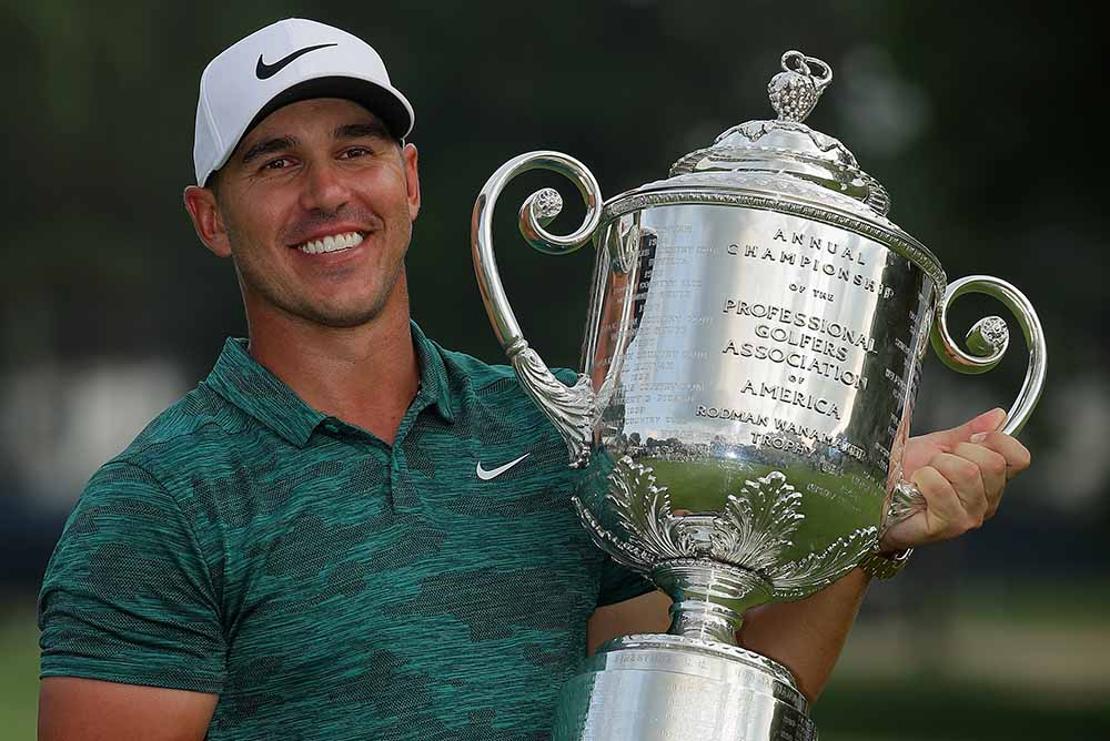 Brooks Koepka poses with the Wanamaker Trophy