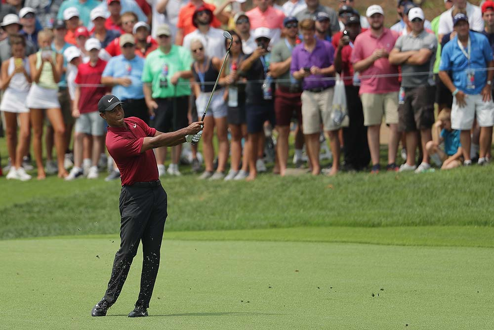 Tiger Woods plays a shot on the 4th