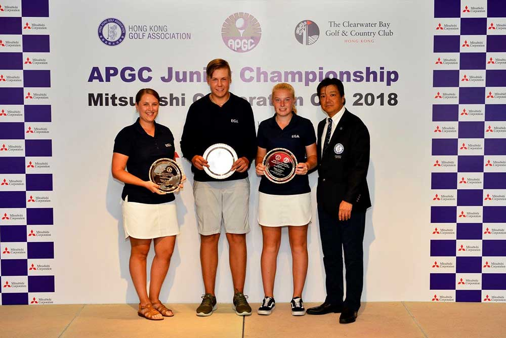 Yoshihiro Nishi, President of HKGA, presents trophies to the winners of the APGC Junior Championship and the Mitsubishi Corporation Cup